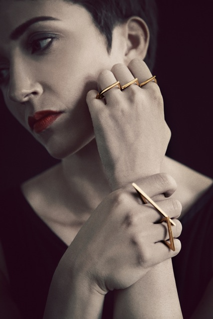 model wears Gold Mountains ring set
